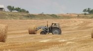 Stock Video Footage of Tractor and Hay Bale