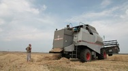 Stock Video Footage of repairing combine harvester