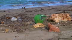 Pollution - Plastic Trash Garbage Rubbish bags left on beach 2 Stock Footage