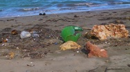 Stock Video Footage of Pollution - Plastic Trash Garbage Rubbish bags left on beach 2