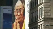 Stock Video Footage of Dalai Lama billboard in NYC (Fast zoom)