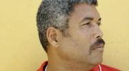 Portrait of hispanic mature man staring at camera Stock Footage