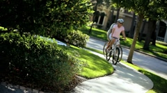 Senior Couple Exercising Outdoors on Bicycles - stock footage