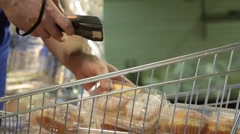Accounting for food at the supermarket - stock footage