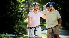 Retirement Cycling Exercise by Healthy Senior Couple - stock footage
