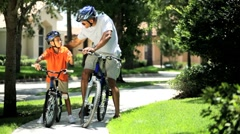 African American Father & Son on Bicycles Together Stock Footage