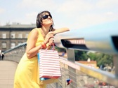 Attractive happy woman with shopping bags smiling to camera Stock Footage