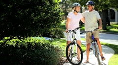 Retirement Healthy Lifestyle with Cycling Seniors Stock Footage