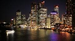 Stock Video Footage of Brisbane City Skyline Night, River Reflections Queensland, Australia