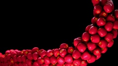 Red Apple flow with slow motion over black. Alpha channel is included Stock Footage