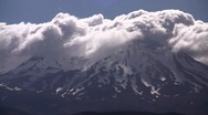 Stock Video Footage of Clouds Rolling Over Mountain 01