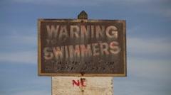 Swim Warning Sign 01 Stock Footage