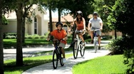 Healthy Ethnic Family Cycling Together Stock Footage
