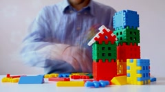 Time lapse. man builds a house out of children's blocks Stock Footage