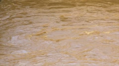 Slow mo whirpool- mud flood rushing river water 4 Stock Footage