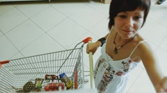 Girl in the shop market Stock Footage