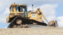 Shot of bulldozer moving earth Stock Footage