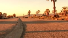 Motorcycle Rider Approaches on Desert Road Dusk 1 Stock Footage