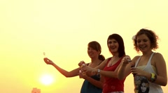 Teens blow bubbles at sunset. Stock Footage