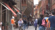 Beautiful pedestrian street Old Town Bologna Italy ancient shopping area tourism Stock Footage