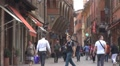 Amazing narrow shopping street old Town Bologna Italy landmark iconic place sign HD Footage