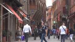 Amazing narrow shopping street old Town Bologna Italy landmark iconic place sign Stock Footage