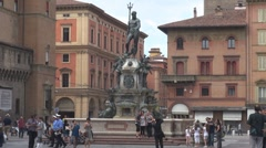 Tourist people enjoy Fountain Neptune Bologna landmark Italy iconic place crowd  Stock Footage