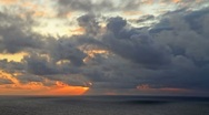 Timelapse Cloudy Sunset with Golden Rays GFTHD Stock Footage