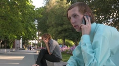 Boy and a Girl Talking on cell phones 3 Stock Footage