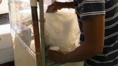 People-Man prepares Puerto Rican Piragua - Flavored Ice Cone Stock Footage