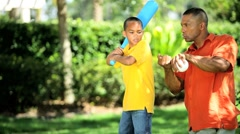 Ethnic Father Teaching Young Son Baseball Stock Footage