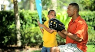 Stock Video Footage of Ethnic Father Teaching Young Son Baseball