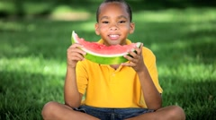 Young Ethnic Boy Eating Healthy Water Melon Stock Footage