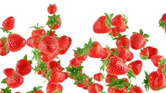 Falling strawberries on white background Stock Footage