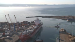 Large container ship leaving port time lapse Stock Footage