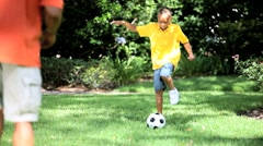 Healthy Ethnic Father & Son with a Football Stock Footage