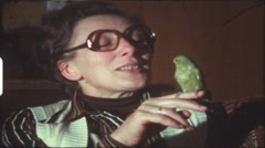 Mother with budgie (vintage 8 mm amateur film) - stock footage