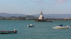 Puerto Rico - Slow moving Tall Tug Boat  - San Juan Bay - small fisherman boats  Stock Footage