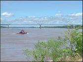 Tug boat and memphis bridge Stock Footage