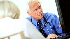 Mature Caucasian Medical Consultant with Patient Stock Footage