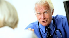 Mature Medical Consultant in Office with Patient Stock Footage