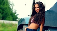 Young beauty girl and lorry truck in summer Stock Footage