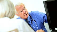 Senior Male Medical Consultant with Patient - stock footage