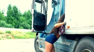 Young girl check lorry truck and walk out Stock Footage