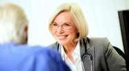 Mature Medical Consultant Conferring with Patient Stock Footage
