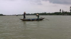 Fisherman casting net on Vietnam river. Stock Footage