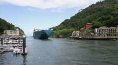 Cargo ship entering port Stock Footage