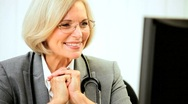 Female Medical Consultant Updating Records Stock Footage
