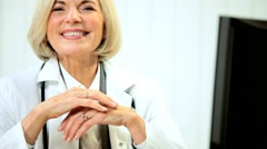 Senior Female Medical Consultant with Computer Stock Footage