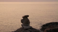 Stack of zen stones with sea in background - stock footage